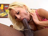 In this scene, Natasha Stone takes on her first black cock.  The guy gives her some pleasure first, fingering her shaved slit.  Next, it's Natasha's turn and she pulls out his massive member.  The size doesn't deter her though and she tries to get it all in her mouth.  She gets her pussy licke
