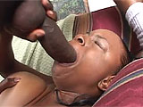 Lola is a black whore, looking to make a deal. She busts out her enormous black titties, while her willing costar pulls out his massive black dick. She blows him, seeming to have some trouble getting all of it in her mouth. The oral goes on for a while, and eventually she finds her rhythm, bobbing h