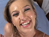 A loud, smiling, smokey blonde is all about the sex toy and laughing during sex. Even when she's getting fucked hardcore, she's giggling, joking and screaming about licking asshole. At one point during this interlude, she uses a vibrator to tickle her clit and she squirts down her legs. Her guy