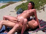 Monique, a sexy brunette, is taking a rock hard cock up her nice and tight pussy on the beach.  Before having her pussy fucked in many different positions, she gives the guys massive johnson some sloppy oral service.