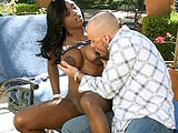 Black hottie, Jade Fire, is hogging up and down on a big white cock by the pool. After her nice mouth service, she gets fucked in a number of positions before swallowing down a big mouthful of jizz.