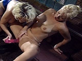 Two sexy blondes are finger fucking one another in a bar.  They soon move to a back alley so they can really get to know each other.  The ladies slowly strip their clothes off as they continue fingering one another.  The action starts to heat up when the ladies start using their tongues and even a d