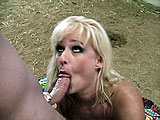 Lizzy, an all natural busty blonde, gets fucked in the great outdoors.  It's pretty nice to see some titty fucking with real boobies.