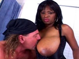 This full figured black hottie is taking a ride on the big hard white pain train.  This train is on a one-way mission for hot black anal action.