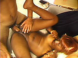 A black slut gets it on with a white guy.  Her big brown round ass sticks up nicely in the air as he takes it to her.