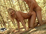 Renee, a sexy blonde, is getting fucked out in the middle of the forest by her boyfriend's big cock.  Once she's done sucking and fucking, her beautiful tits get a nice covering of cum on them.