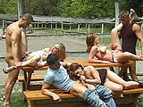 This clip is just one big giant outdoor fuck fest. There are three attractive girls and three guys.  All six of these people are doing the down and nasty with each other on one little picnic table.