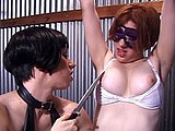Two dominating chicks torture a slave victim.  Tied up and blindfolded, the slave gets her pleasure.