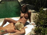 Teanna Kai, an Asian girl, is having  lesbian sex at the pool side.  She does very good work finger banging her girlfriend.