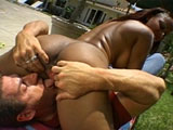 This dark skinned hottie is getting her pussy tongue fucked to all hell by the side of the pool.  Before having her cunt nailed in a number of positions, she gives the guy's massive cock some nice mouth service.