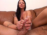 Vandalia, a brunette chick, knows how to stroke the cock with her feet.  She gives a good no hands blowjob too.