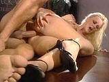 Hannah Harper, a sexy blonde, is trying to explain to her boss why the public needs to know about the nymph-fever virus.  When he doesn't listen, she takes drastic measures to get his attention.  She pulls out his big cock and starts sucking on it.  When that still doesn't work, it's time for her to