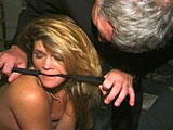 A master spanks his slave.  He ties her up.  Part of the rope is pulling up on her pussy and asshole. Then the master flogs her back and ass.  The master brings out 