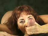 A hot redhead MILF is giving a sloppy suckjob. It sounds hot as she coughs and gags as the guy pounds his cock in and out of her mouth.