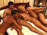 A sexy Latin blonde is getting her pussy nailed by three very bi-curious guys.  This hottie finds she's not only one with a cock in her mouth.  