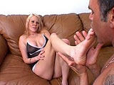 This hot ass blonde is getting her toes sucked on. After stroking the guy with her feet, she sucks him off.