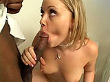 Amber Peach, a sexy blonde, is finger fucking herself as she sits on the toilet.  She is soon joined by a black guy and after a little bit foreplay, he thrusts his big cock into her ass.