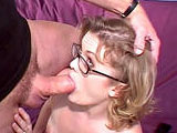 Erika, a cute honey blonde, is getting dicked by two guys as her hubby kicks back and watches.  She gives both guy's a hot dual BJ  before getting fucked.